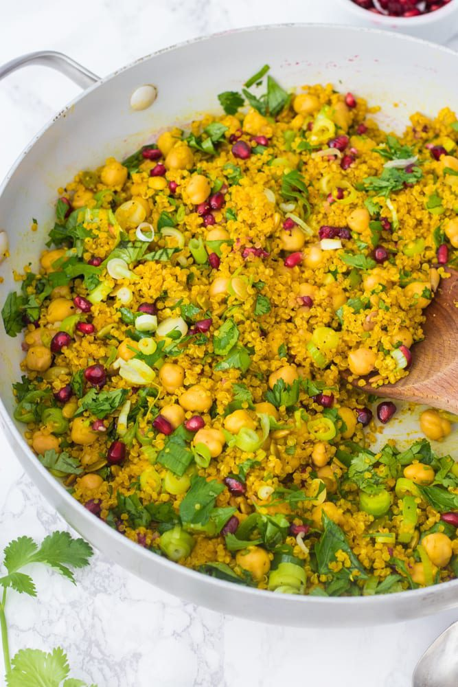 perfectly cooked curried quinoa being stirred