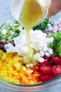 Lemon Garlic Dressing Poured over Mediterranean Quinoa Salad