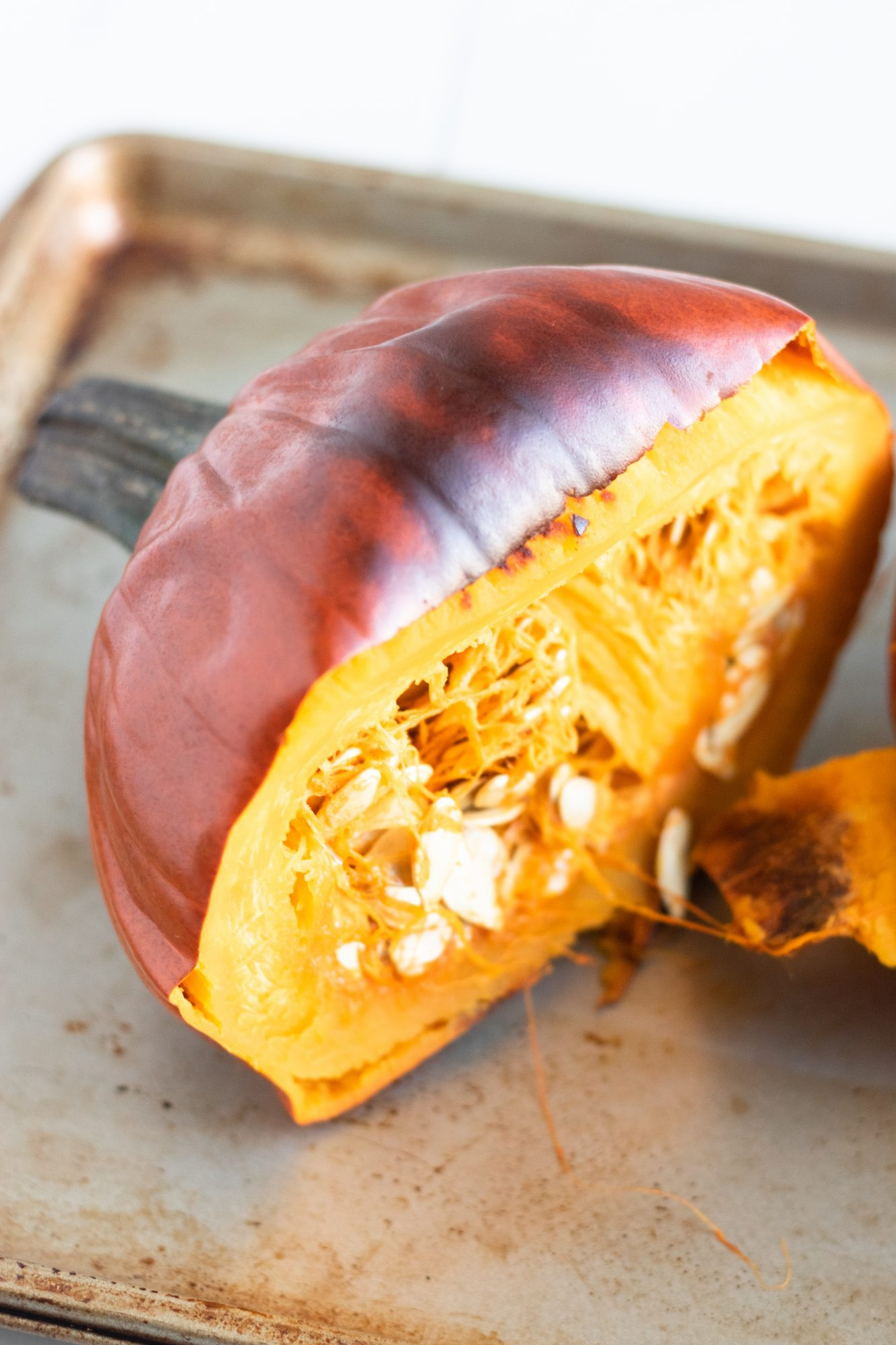 Oven Baked Whole Pumpkin Cut in Half