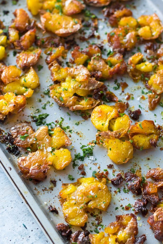 Crispy Smashed Potatoes sprinkled with parsley and salt