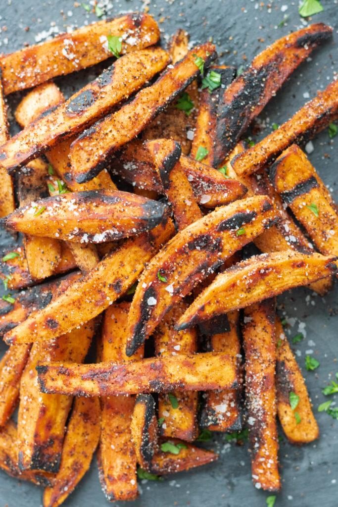 grilled sweet potato fries overhead on black serving platter