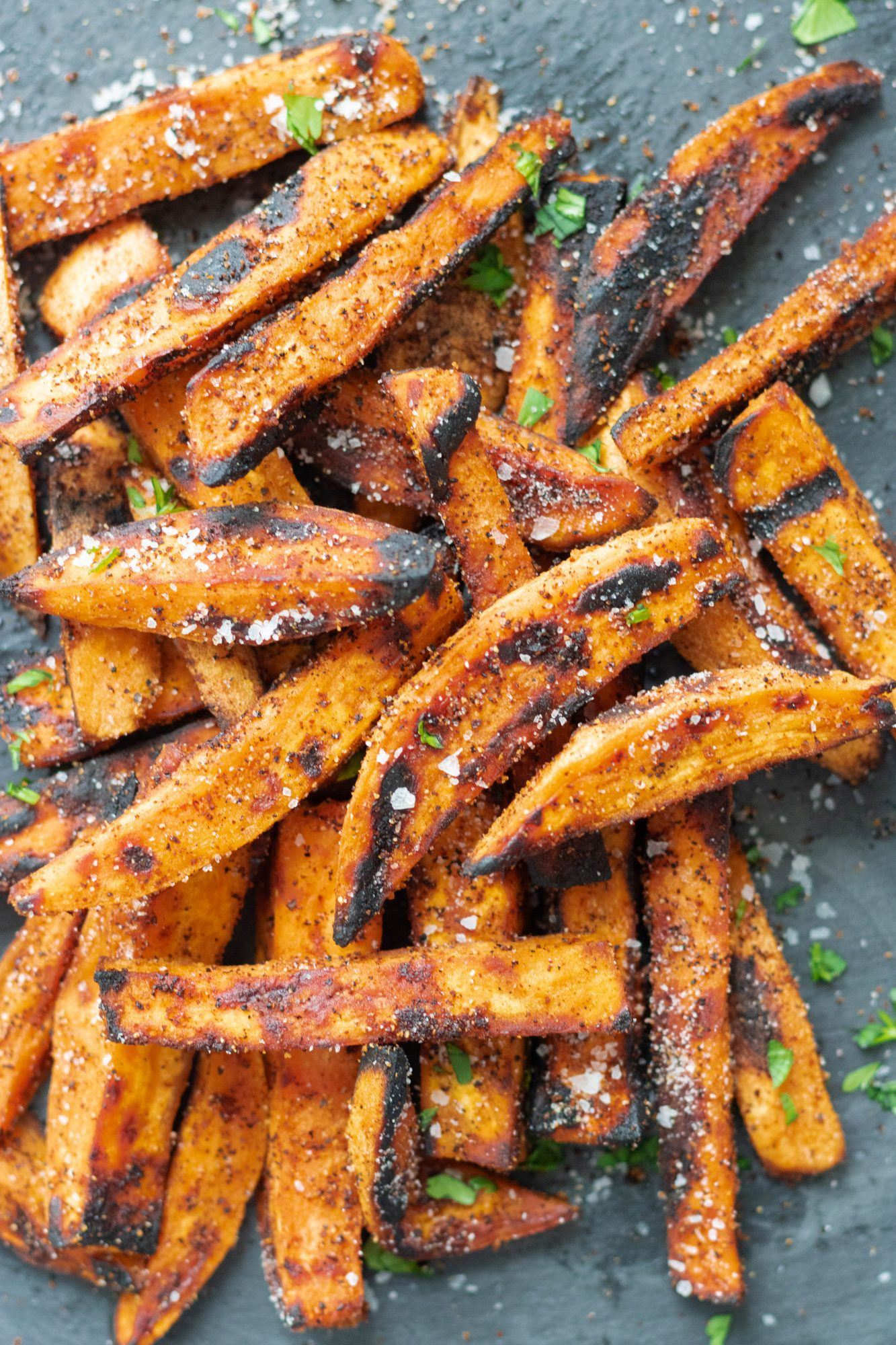 grilled sweet potato fries overhead on black serving platter