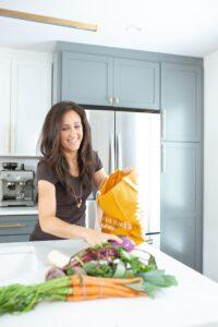 Elaine unloading veggies in kitchen