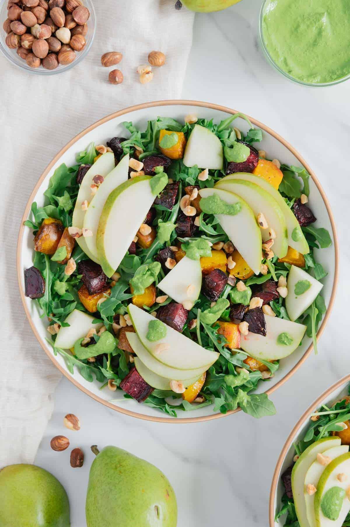 Pear and Roasted Beet Arugula Salad with Hazelnuts